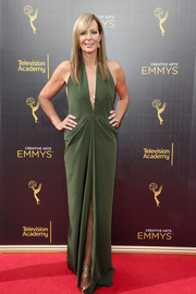 Allison Janney was all about sexy glamour in a plunging green halter gown by Bert Keeter at the 2016 Creative Arts Emmy Awards.