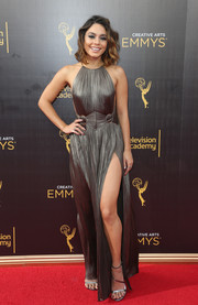 Vanessa Hudgens was a stunner in this high-slit gunmetal-gray halter gown by Maria Lucia Hohan at the 2016 Creative Arts Emmy Awards.