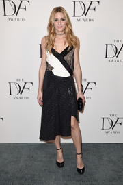 Olivia Palermo teamed her cami with a sequined black wrap skirt, also by Diane von Furstenberg.