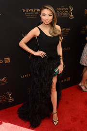 Jeannie Mai went for full-on glamour in a black Rani Zakhem one-shoulder gown with a feathered skirt and a thigh-high slit at the 2016 Daytime Emmy Awards.