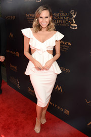 Keltie Knight hit the 2016 Daytime Emmy Awards red carpet looking flirty in a white ruffle cutout dress by Fame and Partners.