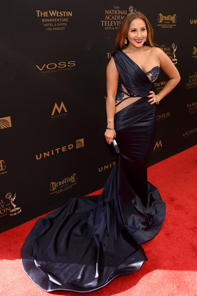Adrienne Bailon brought a high dose of Old Hollywood glamour to the 2016 Daytime Emmy Awards with this flowing midnight-blue one-shoulder gown by Walter Mendez.