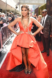 Tamar Braxton styled her provocative dress with strappy black peep-toes.