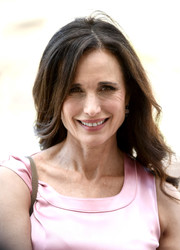 Andie MacDowell styled her hair with an off-center part and soft waves for day 6 of the Dubai International Film Festival.