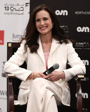 Andie MacDowell suited up in a white blazer and matching pants for day 6 of the Dubai International Film Festival.