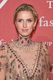 Nicky Hilton oozed boho charm wearing this center-parted braided updo at the 2016 Fashion Group International Night of Stars Gala.