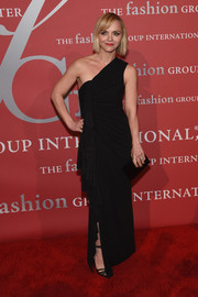 Christina Ricci was a classic beauty at the 2016 Fashion Group International Night of Stars Gala in a ruched black one-shoulder gown with folds of fabric cascading down the side.