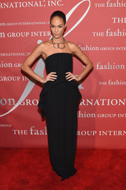 Joan Smalls opted for a simple yet sophisticated strapless peplum gown by Givenchy when she attended the 2016 Fashion Group International Night of Stars Gala.