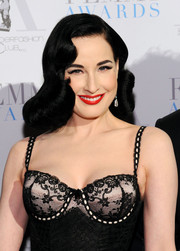 Dita Von Teese's red lippy looked gorgeous against her alabaster skin.