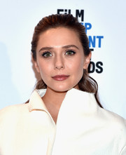 Elizabeth Olsen kept it youthful with this partless ponytail at the Film Independent Spirit Awards nomination press conference.