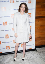 Kristen Stewart went conservative and classic in a white tweed skirt suit by Chanel for the Film Society of Lincoln Center luncheon.