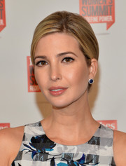 Ivanka Trump opted for a conservative side-parted updo when she attended the Forbes Women's Summit.