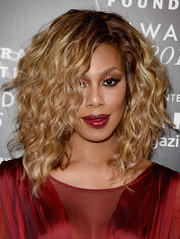 Laverne Cox looked sassy at the 2016 Fragrance Foundation Awards wearing this voluminous curly 'do.