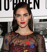 Hilary Rhoda swiped on some glossy red lipstick to round out her colorful look.