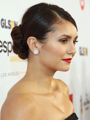 Nina Dobrev polished off her look with a pair of clover-shaped diamond studs.