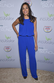 Rosario Dawson kept it relaxed yet stylish in an electric-blue halter jumpsuit by St. John at the 2016 Garden Brunch.