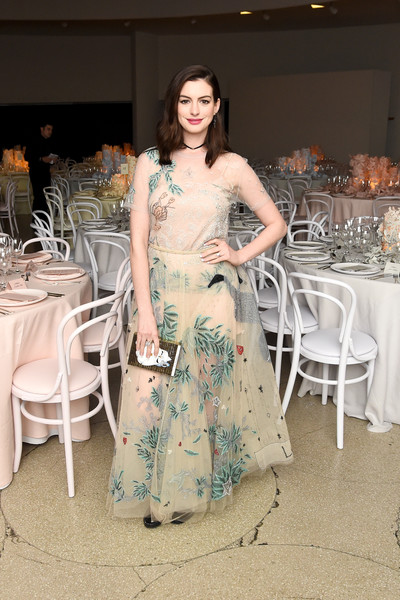Anne Hathaway completed her dreamy look with a matching maxi skirt.