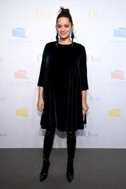 Marion Cotillard went minimalist in a dark-teal velvet shift dress by Christian Dior at the 2016 Guggenheim International pre-party.