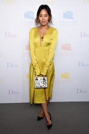 Aimee Song added a touch of print with a floral purse by Dior.