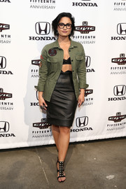 Demi Lovato layered a Zadig & Voltaire military jacket over a black bra top for an edgy-sexy look during the Honda Civic Tour Artists announcement.