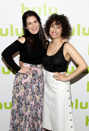 Abbi Jacobson attended the 2016 Hulu Upfront wearing a black cold-shoulder turtleneck and a floral skirt.