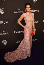 Nina Dobrev looked glam in a pink lace Max Azria Atelier gown with a fishtail hem at the 2016 Golden Globes after parties.