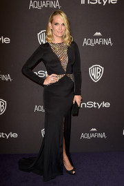 Molly Sims was edgy-glam at the InStyle and Warner Bros. Golden Globes post-party in a black gown with crystal-studded sheer panels.