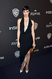 Paz Vega was the picture of cool elegance at the InStyle and Warner Bros. Golden Globes post-party in a black-and-white tux-inspired dress with a plunging neckline and an asymmetrical hem.