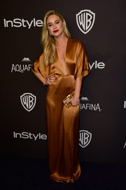 Becca Tobin kept the shine coming with a textured gold clutch.