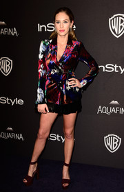 Dylan Penn looked exuberant in a colorful jacket teamed with black shorts, both by Armani, at the InStyle and Warner Bros. Golden Globes post-party.