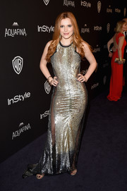 Bella Thorne unleashed her inner vixen in a mesh-panel sequin gown by Julien MacDonald during the InStyle and Warner Bros. Golden Globes post-party.
