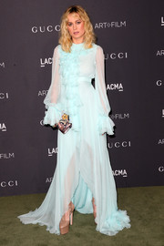 Brie Larson chose a frilly pastel-blue Gucci gown, featuring a high-low hem and a flurry of ruffles, for the 2016 LACMA Art + Film Gala.