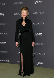 Melanie Griffith flaunted her ageless physique in a low-cut black gown at the 2016 LACMA Art + Film Gala.