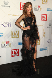 Dannii Minogue dared to bare in a sheer, feather-festooned gown by Ae'lkemi at the Logie Awards.
