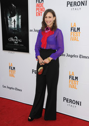 Vera Farmiga paired her boldly-hued blouse with black wide-leg pants.