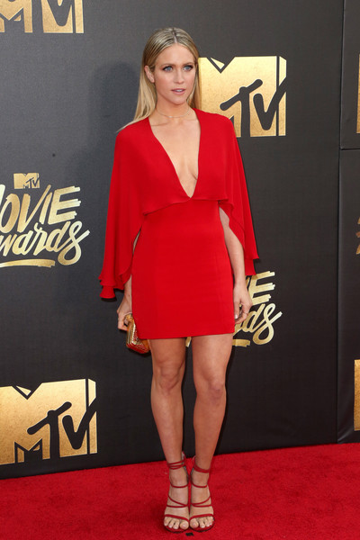 Brittany Snow matched her dress with strappy red heels by Stuart Weitzman.