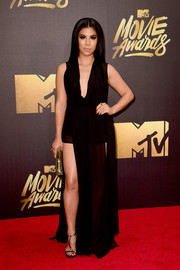 Chrissie Fit styled her dress with gold T-strap sandals by Greymer.