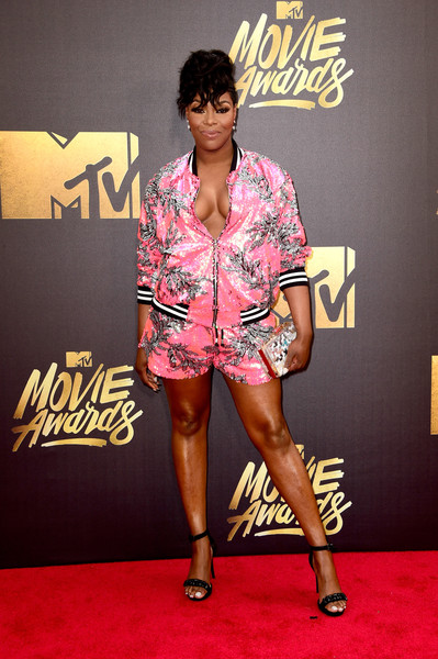 Ta'Rhonda Jones caught plenty of eyes with her sequined pink jacket and shorts ensemble at the MTV Movie Awards.
