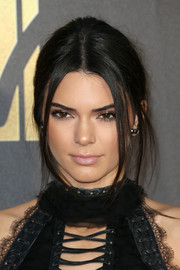 Kendall Jenner played down her lips with this pale pink hue when she attended the MTV Movie Awards.