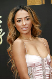 Kat Graham wore her long hair down in a sexy wavy style for her MTV Movie Awards look.