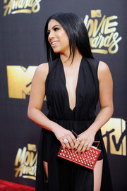Chrissie Fit attended the MTV Movie Awards carrying a super-chic studded clutch by Sara Battaglia.