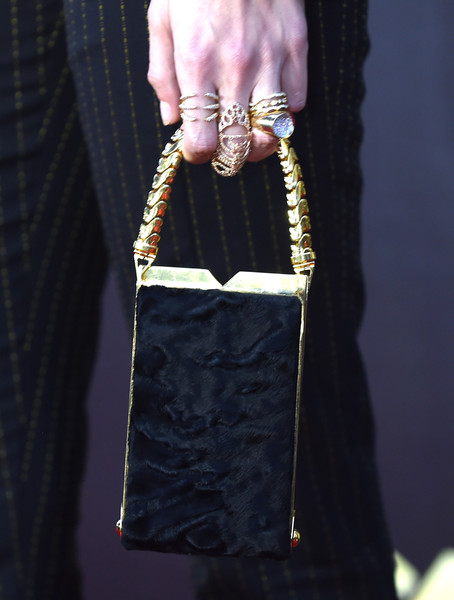 More Pics of Gigi Hadid Statement Ring (1 of 16) - Decorative Rings Lookbook - StyleBistro [red carpet,fashion,bag,handbag,fashion accessory,hand,leather,material property,street fashion,zipper,chain,gigi hadid,mtv movie awards,fashion detail,burbank,pt,california,warner bros. studios]