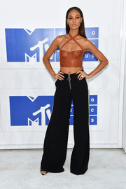 Joan Smalls was fetish-chic in a tan leather crop-top with crisscross shoulder straps at the 2016 MTV VMAs.