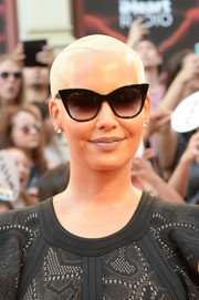 Amber Rose topped off her look with a blonde buzzcut.