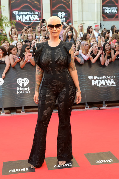 Amber Rose flaunted her voluptuous figure in a body-con black jumpsuit by Herve Leger during the 2016 Much Music Video Awards.