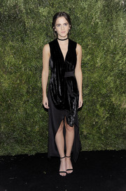 Emma Watson complemented her frock with a pair of black Stuart Weitzman NearlyNude sandals.