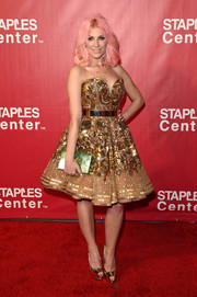 Bonnie McKee looked like Barbie with her intricately beaded gold strapless dress (and pink hair) at the MusiCares Person of the Year event.