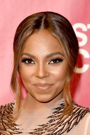 Ashanti pulled her hair back into a center-parted ponytail with loose tendrils for the MusiCares Person of the Year event.