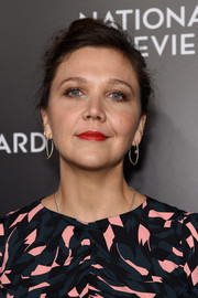 Maggie Gyllenhaal styled her hair into a loose bun for the National Board of Review Gala.