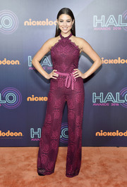 Kira Kosarin went for some '70s groove in a magenta lace halter jumpsuit by Alexis at the 2016 HALO Awards.